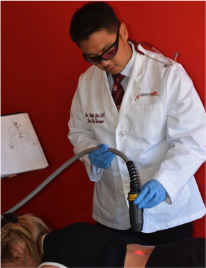 laser-therapy-dr-yoo-working-on-patient-spine