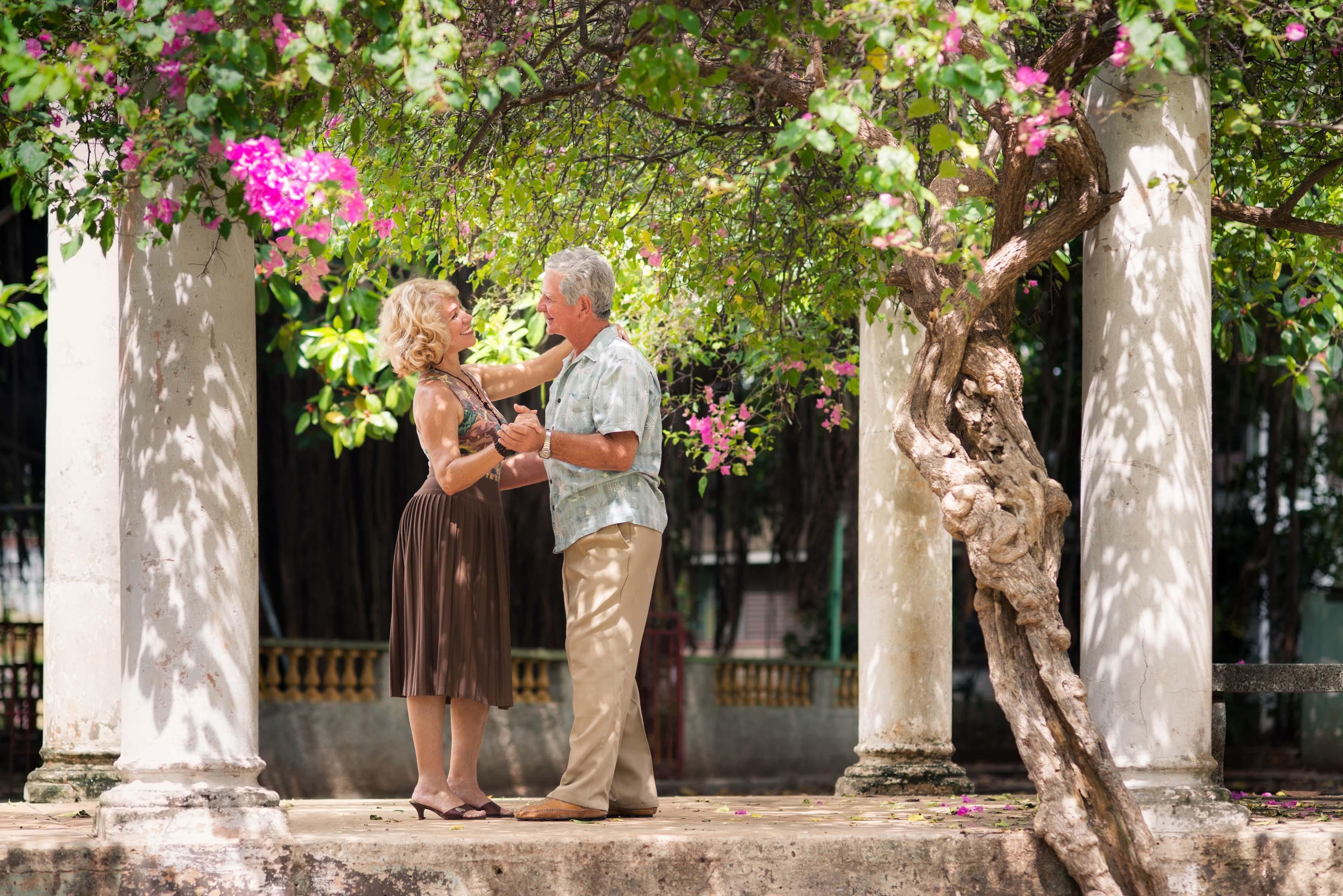 Happy senior couple dancing latin american dance for fun